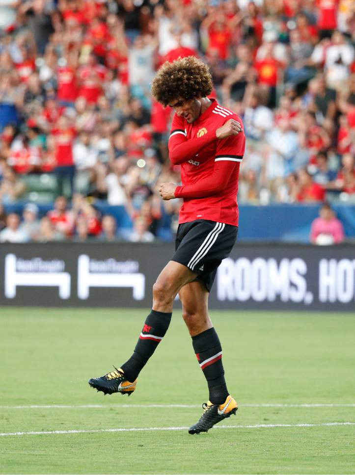 Manchester United's Marouane Fellaini celebrates his goal during the first half of a friendly soccer match against the Los Angeles Galaxy Saturday, July 15, 2017, in Carson, Calif. (AP Photo/Jae C. Hong)