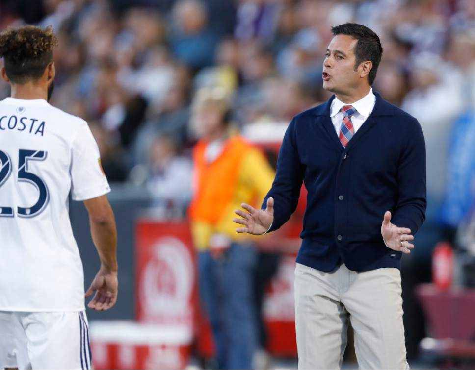 Real Salt Lake midfielder Danilo Acosta, left, is directed by head coach Mike Petke while facing the Colorado Rapids in the first half of an MLS soccer match, Saturday, April 15, 2017, in Commerce City, Colo. (AP Photo/David Zalubowski)