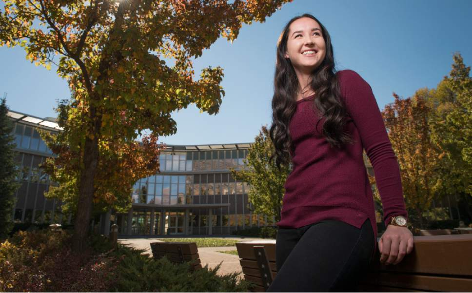 """Leah Hogsten     The Salt Lake Tribune """"I'm happy about the policy change,"""" said former BYU student Madi Barney of Brigham Young University's announcement Wednesday, October 26, 2016 not to punish sexual assault victims for Honor Code violations in connection with their reports. """"It was my goal all along,"""" said Barney who launched the petition requesting Honor Code amnesty for BYU students who report sex crimes. Barney is pictured in front of BYU's Abraham O. Smoot Administration Building. The policy change follows the recommendations of an internal study group formed after multiple current and former students this spring said they were investigated for violations of the schoolÌs chastity requirement and other rules when they reported being sexually assaulted."""