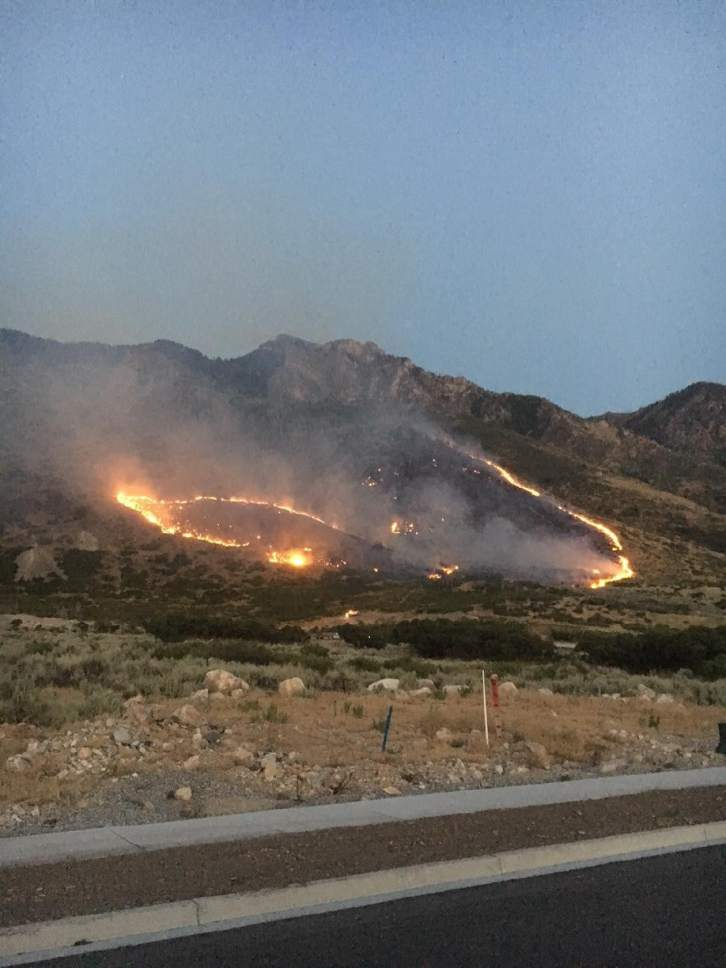 Courtesy KUTV News  Crews were making rapid progress hemming in the 397-acre Water Tower Fire in Utah County on Monday.