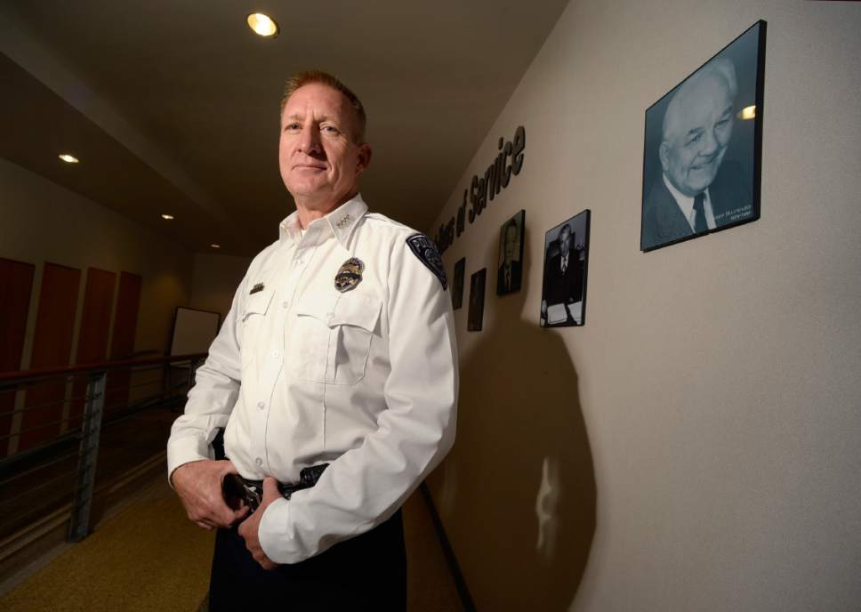 Scott Sommerdorf   |  The Salt Lake Tribune   Sheriff Jim Winder poses for a portrait in the hallway at the Salt Lake Sheriff's building where portraits of former Sheriffs are posted, Saturday, July 15, 2017.