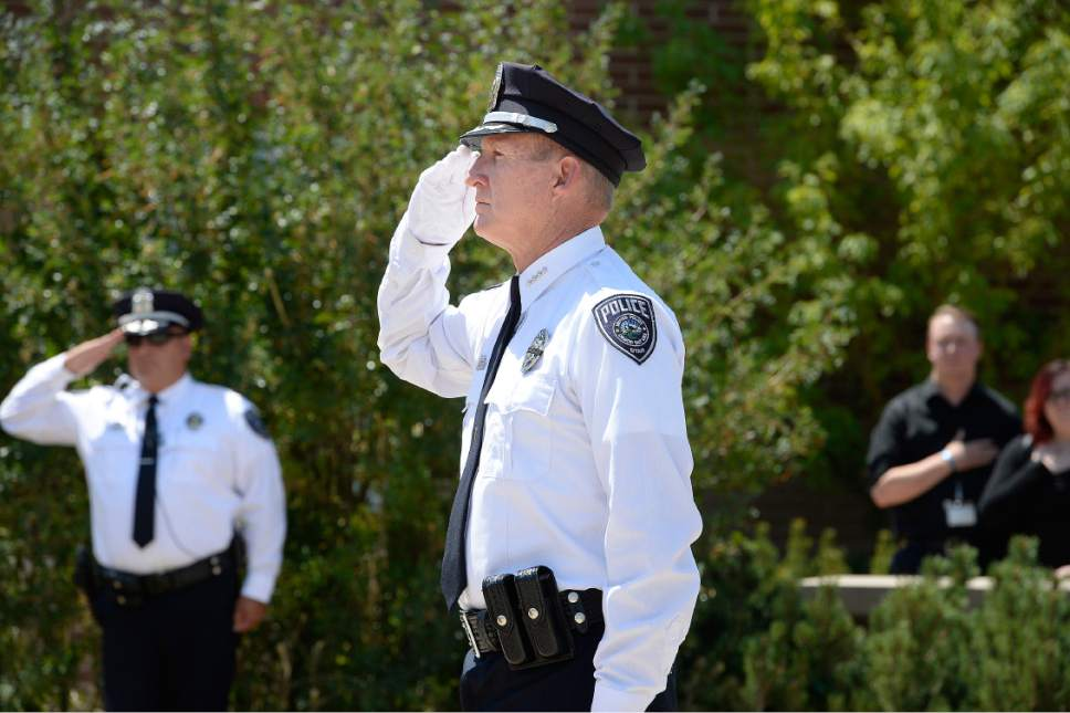 "Scott Sommerdorf   |  The Salt Lake Tribune   Sheriff Jim Winder, during the memorial service for ""Dingo,"" a Unified Police Department dog shot and killed in the line of duty July 6 while working with his K-9 handler Sgt. Chad Reyes, Saturday, July 15, 2017."