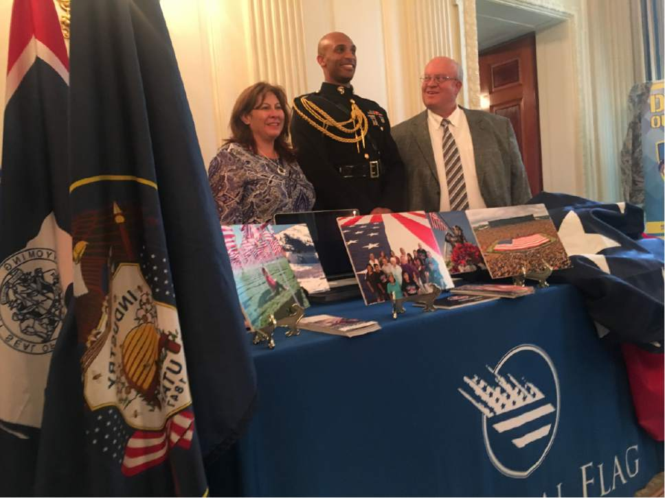 Thomas Burr  |  The Salt Lake Tribune   Valerie Kelly, left, and Paul Swenson, right, pose with a Marine Corps captain at the White House on Monday as part of the Trump administration's showcase of Made in America products.