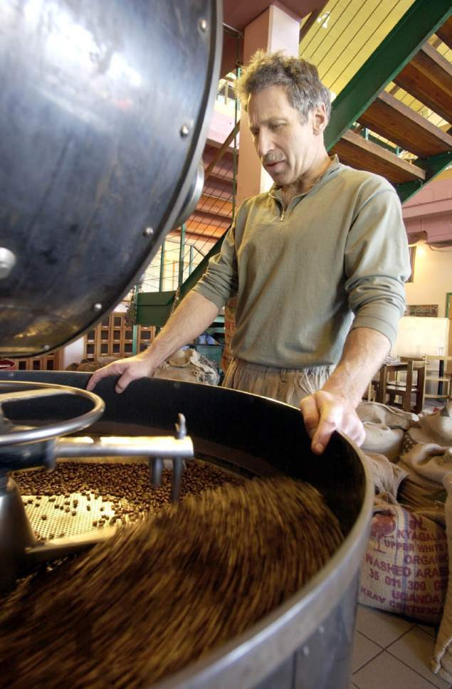 Tribune File Photo  John Bolton, of The Salt Lake Roasting Co. watches as freshly roasted beans are cooled in this undated photo.