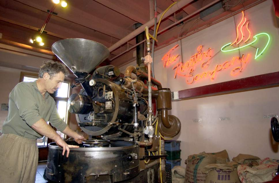 Tribune File Photo  John Bolton tinkers with the coffe roaster at the Salt Lake Roasting Co.  Bolton roasts fresh beans  for the coffe shop as well as other retail outlets  in this undated photo.