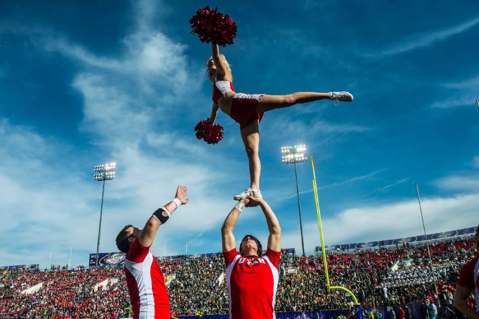 Chris Detrick  |  The Salt Lake Tribune Utah cheerleaders perform during the Royal Purple Las Vegas Bowl at Sam Boyd Stadium Saturday December 20, 2014.