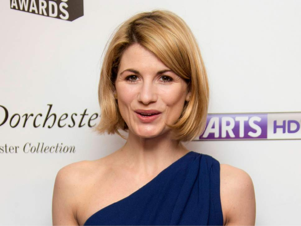 """FILE - In this file photo dated Monday, Jan. 27, 2014, British actress Jodie Whittaker, who starred in TV series Broadchurch, arrives for South Bank Sky Arts Awards 2014, held at the Dorchester hotel in central London. The BBC has announced Sunday July 16, 2017,  Jodie Whittaker is the next star of the long-running science fiction TV series """"Doctor Who"""" set to become the first woman to take the leading title role.  (FILE Photo by Joel Ryan/Invision/AP)"""