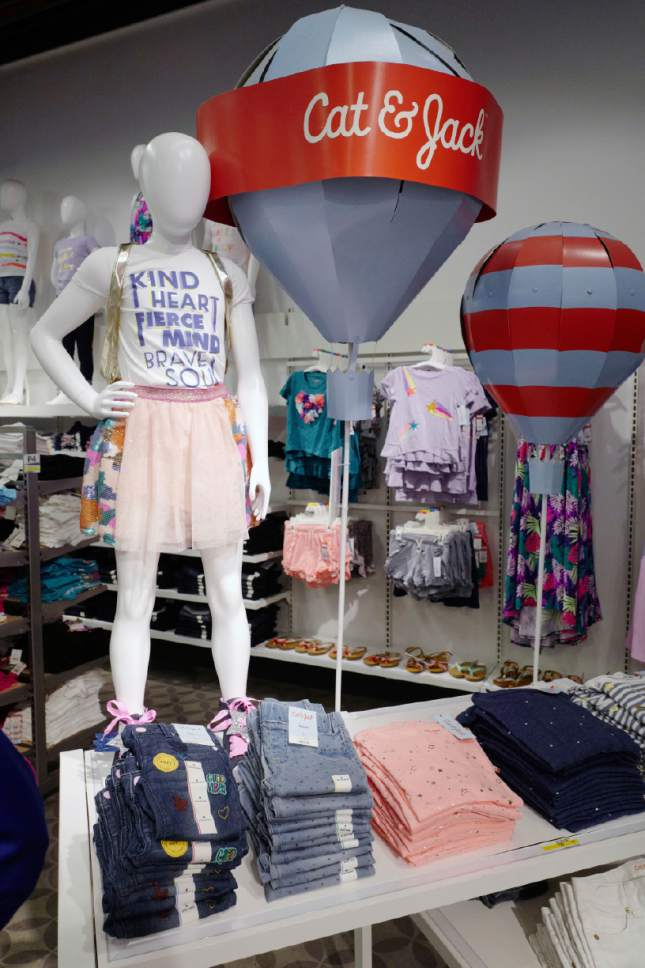 In this Friday, July 14, 2017, photo, Cat & Jack jeans and T-shirts appear on display at a Target store in New York. The clothes are made with Repreve polyester fabric, created from recycled plastic bottles.  (AP Photo/Mark Lennihan)