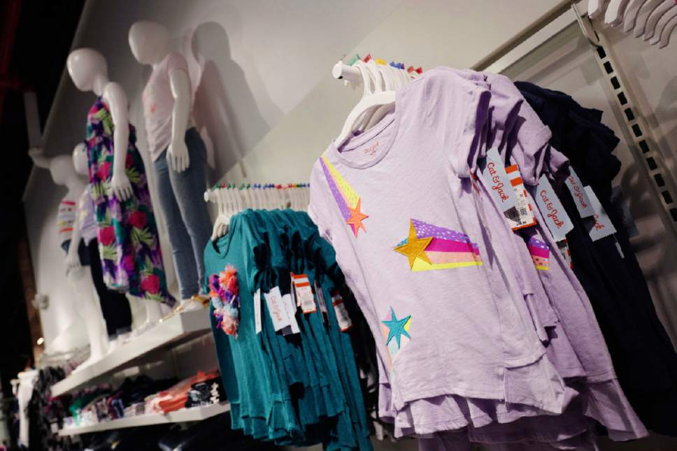 This Friday, July 14, 2017, photo shows Cat & Jack tops for girls made with Repreve polyester fabric created from recycled plastic bottles, on display at a Target store, in New York. For this year's back-to-school shopping season, green is the new black. Increasingly, parents and their kids are looking for second-hand clothing or fashions made from reused material. (AP Photo/Mark Lennihan)