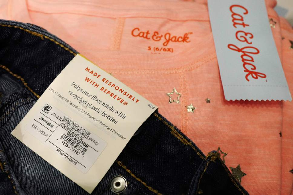 In this Friday, July 14, 2017, photo, a label in Cat & Jack jeans displayed at a Target store in New York indicates that they are made with 22 percent Repreve recycled polyester fabric. Target started offering fashions made of polyester created from recycled plastic bottles with last year's launch of its own Cat & Jack children's brand. The move came after seeing interest in eco-friendly products in its focus groups with parents and children. (AP Photo/Mark Lennihan)