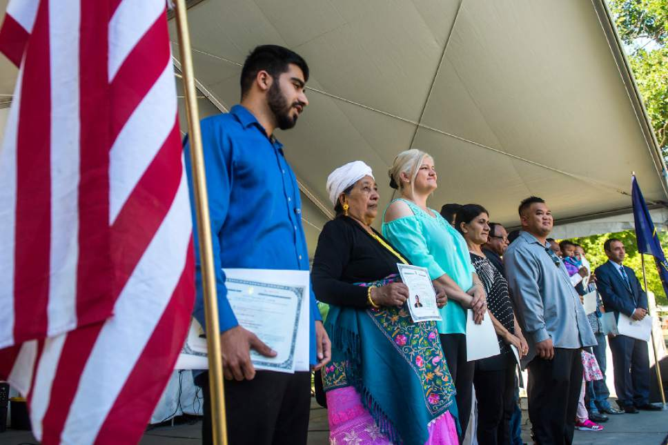 Chris Detrick  |  The Salt Lake Tribune New citizens of United States of America are introduced during World Refugee Day at Liberty Park Saturday, July 15, 2017.