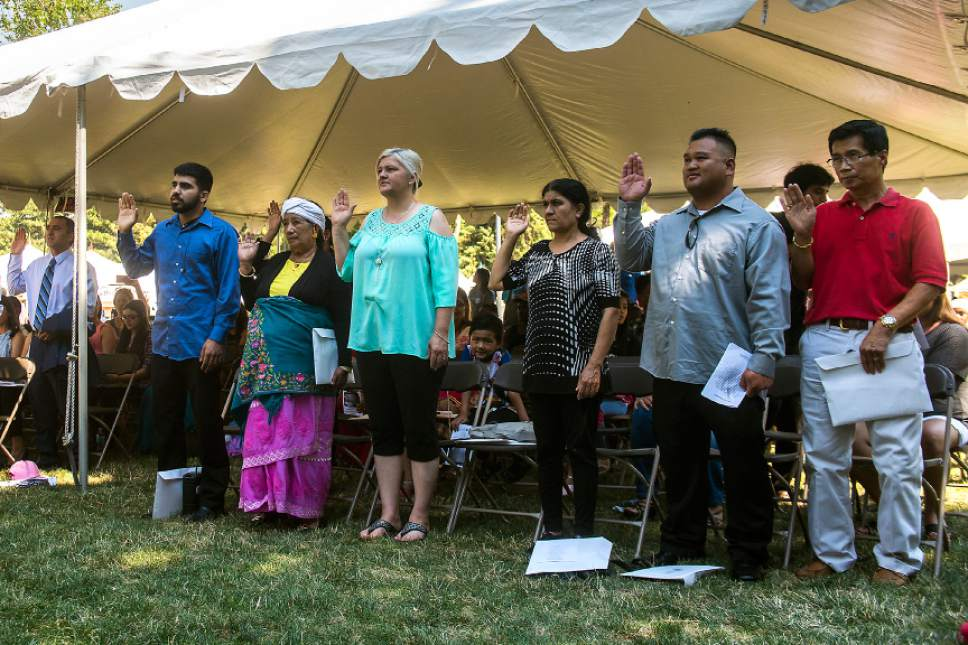 Chris Detrick  |  The Salt Lake Tribune Refugees take the Oath of Allegiance to become new citizens of United States of America during World Refugee Day at Liberty Park Saturday, July 15, 2017.