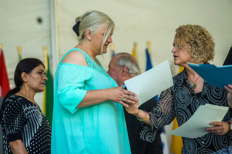 Chris Detrick  |  The Salt Lake Tribune Fatima Mehmedovic, 44, of West Jordan, receives a certificate from Salt Lake City Mayor Jackie Biskupski  during World Refugee Day at Liberty Park Saturday, July 15, 2017. Mehmedovic became a citizen of United States of America after having lived here for the past 29 years.
