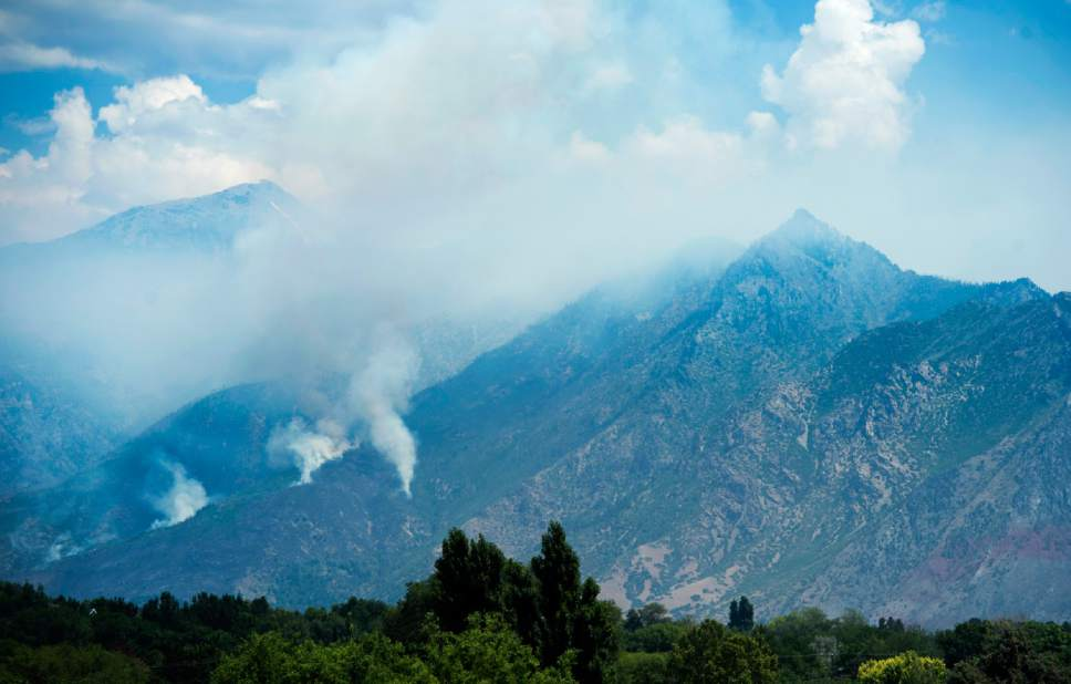 Rick Egan  |  The Salt Lake Tribune  Smoke from the fire in the hills above Alpine, Sunday, July 16, 2017.