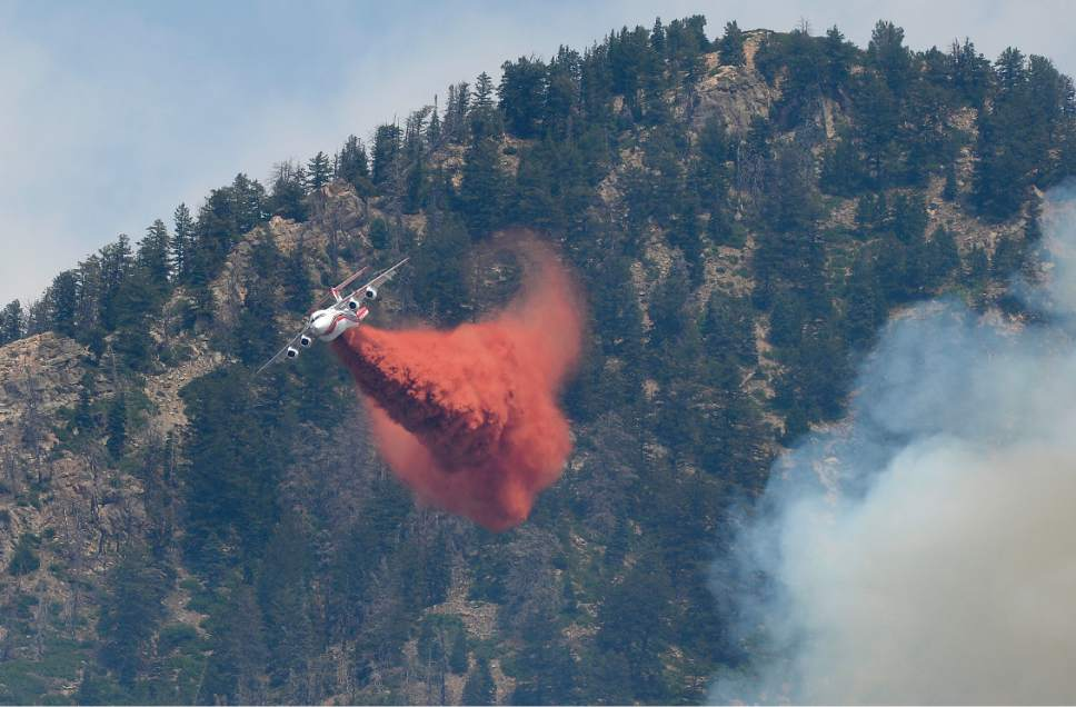 Scott Sommerdorf   |  The Salt Lake Tribune   Aerial crews fight the fires being driven uphill as seen from Creekside Park in Alpine, Sunday, July 16, 2017.