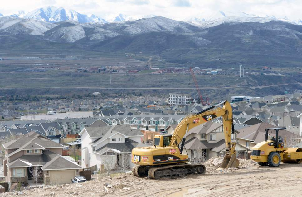 Al Hartmann  |   Tribune file photo New houses have sprung up just north of I-15 in Lehi near the Outlets at Traverse Mountain.  Utah County is growing at a rapid rate, and is expected to draw close to Salt Lake County's population over the next 50 years.