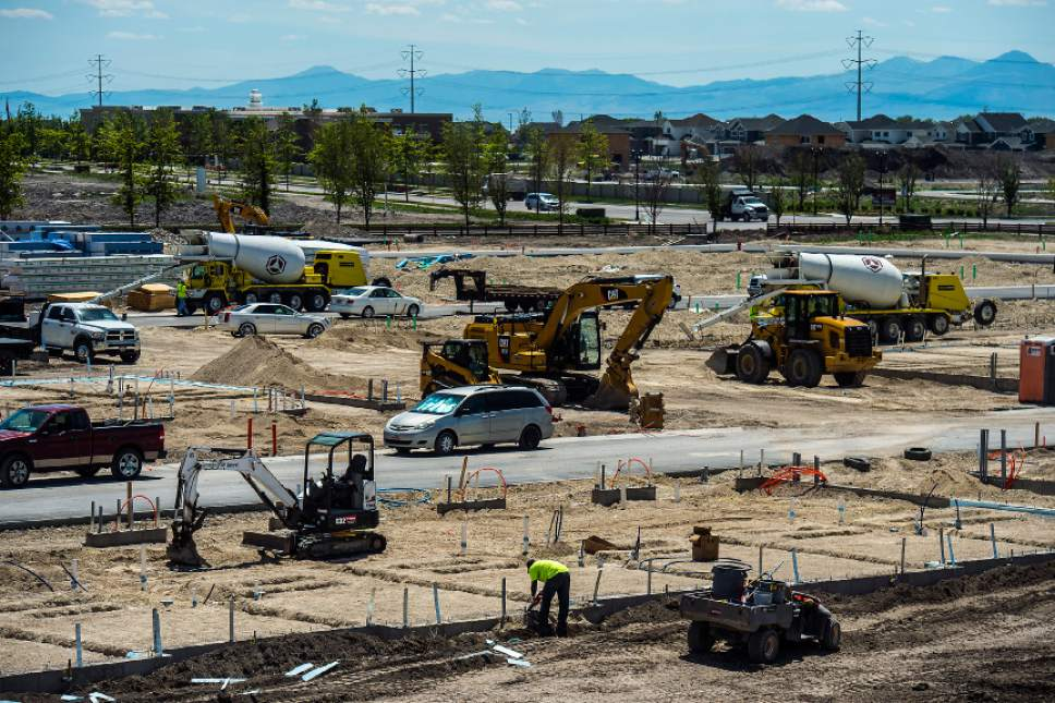 Chris Detrick  |   Tribune file photo Construction continues on new buildings in Vineyard City Tuesday, May 23, 2017.