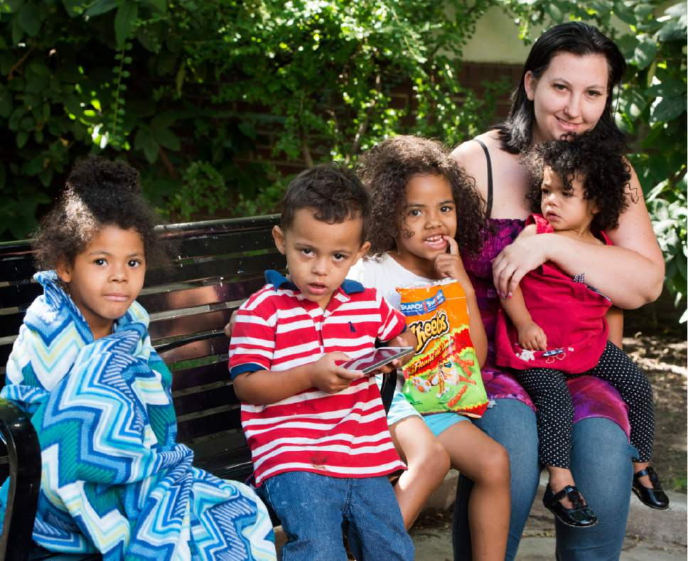 Rick Egan  |  Tribune file photo  Justina Shields with her children, left to right, Laila, William, Maliha and Averyonna at the Road Home on Thursday, July 13, 2017.