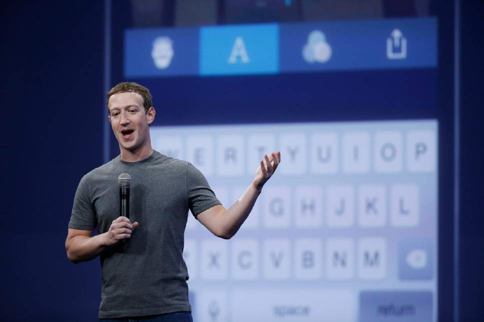 CEO Mark Zuckerberg gestures while delivering the keynote address at the Facebook F8 Developer Conference Wednesday, March 25, 2015, in San Francisco. (AP Photo/Eric Risberg)