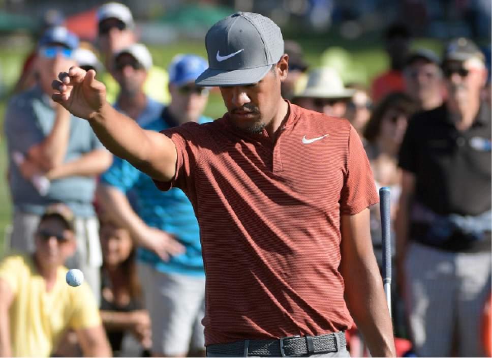 Tony Finau takes a drop off the 17th green during the third round of the Arnold Palmer Invitational golf tournament in Orlando, Fla., Saturday, March 18, 2017. (AP Photo/Phelan M. Ebenhack)