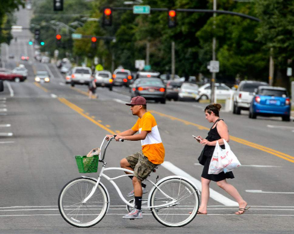 Steve Griffin  |  The Salt Lake Tribune   A cyclist crosses 300 south at 500 east in Salt Lake City Wednesday July 19, 2017.
