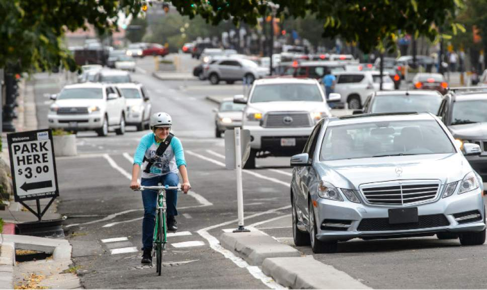Steve Griffin  |  The Salt Lake Tribune   A cyclist rides in the 300 south bike lane in Salt Lake City Wednesday July 19, 2017.