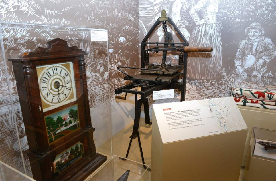 """Al Hartmann     The Salt Lake Tribune Clock of Joel Ricks, who crossed in plains 1848, left, and printing press from Boston sent west with Howard Egan in 1849.  They are some of the many historical items in """"Mormon Trails: Pathways to Zion,""""  a new exhibit at the LDS Church History Museum that opens Thursday, July 13."""