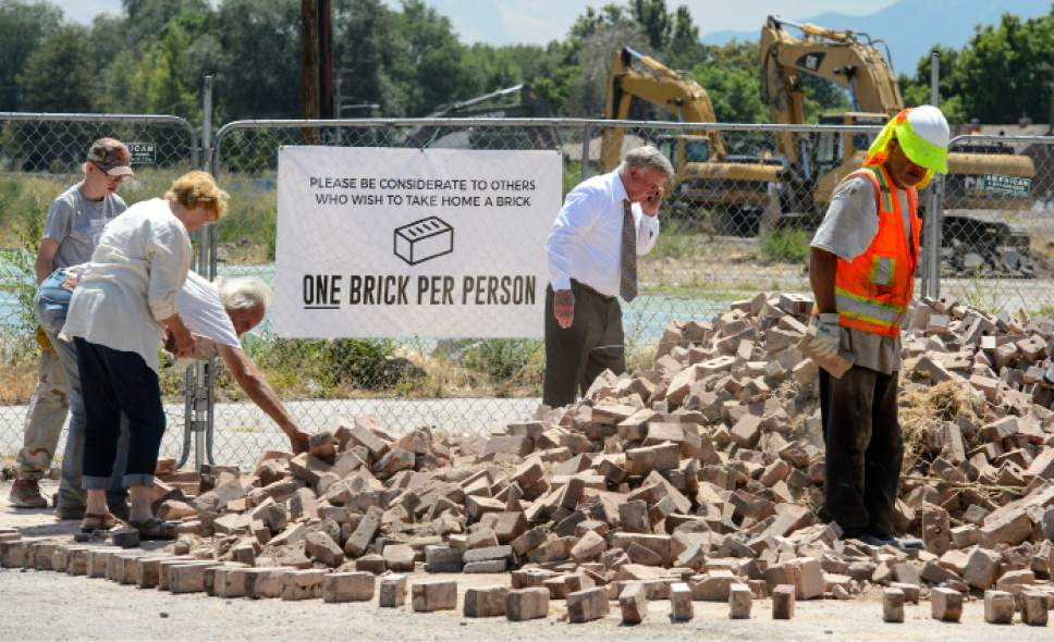 Steve Griffin  |  The Salt Lake Tribune   Bricks from Granite High School are being made available to the public as the school is demolished in Salt Lake City Tuesday July 18, 2017. Bricks can be picked up in the east parking lot o the school.