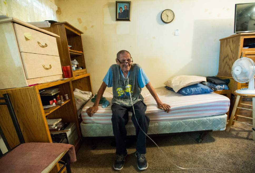 Rick Egan  |  The Salt Lake Tribune  Juan Linares talks about how he survives in the hot summer in his South Salt Lake apartment. Friday, July 14, 2017.