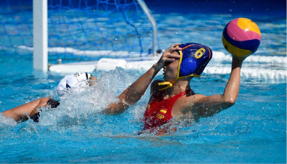 US Rachel Fattal, left, and Helena Lloret Gomez of Spain  compete during their women's water polo Group B second round match USA vs Spain of the Swimming World Championships in Hajos Alfred National Swimming Pool in Budapest, Hungary, Tuesday, July 18, 2017. (Balazs Czagany/MTI via AP)