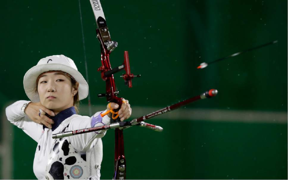 South Korea's Choi Mi-sun releases her arrow during an elimination round of the individual archery competition at the Sambadrome venue during the 2016 Summer Olympics in Rio de Janeiro, Brazil, Wednesday, Aug. 10, 2016. (AP Photo/Alessandra Tarantino)