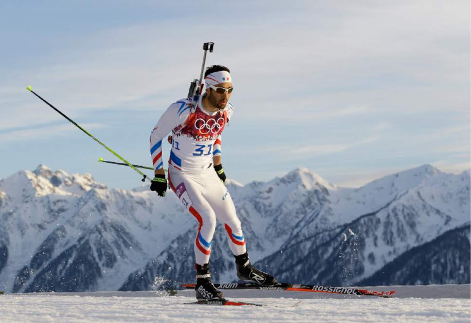 France's Martin Fourcade skis during the men's biathlon 20k individual race, at the 2014 Winter Olympics, Thursday, Feb. 13, 2014, in Krasnaya Polyana, Russia. (AP Photo/Kirsty Wigglesworth)