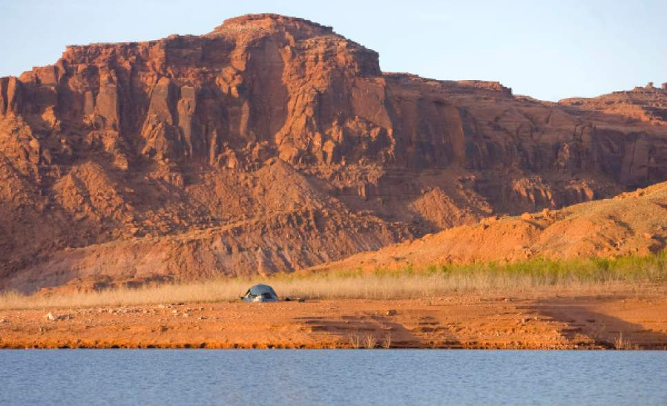 Al Hartmann     Tribune file photo A shot of Good Hope Bay on Lake Powell.  Utah Gov. Gary Herbert  on Wednesday accepted a 50-year water management report from a team of advisors. The 106-page document emphasizes conservation, while also including mention of controversial water-development projects such as the Lake Powell pipeline and the Bear River project.