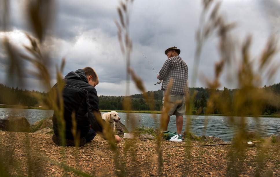Leah Hogsten     The Salt Lake Tribune Tom Lyle and his grandson Gavin Rhodes, 9, fish for brook and Rainbow trout at Duck Creek Pond in the Dixie Nation Forest, off of Scenic Highway 14.