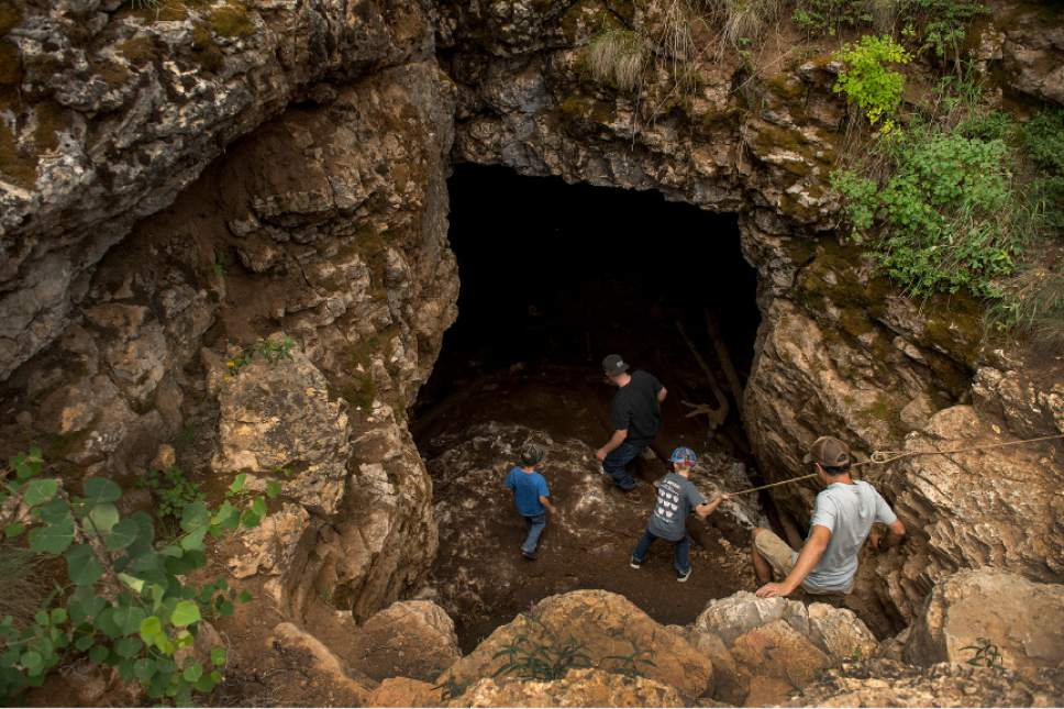 Leah Hogsten     The Salt Lake Tribune Visitors to Duck Creek Ice Cave lower themselves into the cave July 15, 2017 with a rope anchored at the entrance. Duck Creek Ice Cave measures about 60 feet by 40 feet, with a ceiling height of 15 feet high. The ice cave is located in Tertiary limestone deposits that are 30 to 50 million years old. Winter ice and snow melts in the warmer months, although even on a hot summer day, the floor temperature is just above freezing.