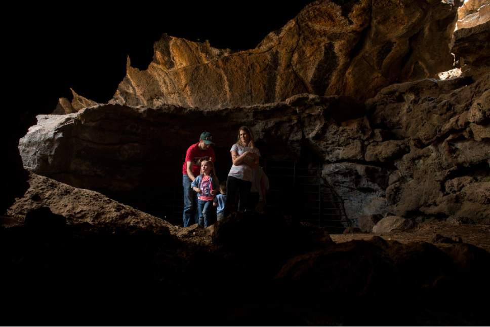 Leah Hogsten     The Salt Lake Tribune Danny Johnson, wife Kayla, daughter Lucy, 4, and son Spencer, 2, peek into two of the three entrances to Mammoth Cave, one of the largest lava tubes in Utah, with over 2200 feet of passages. Located on the Markagunt Plateau, the cave was formed by cooling lava and water less than 2,000 years ago.