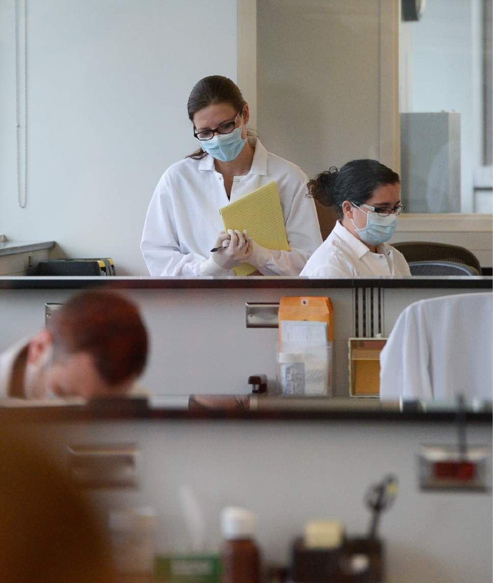 Francisco Kjolseth | The Salt Lake Tribune Technicians process rape kits in the screening area of the DPS Crime Lab in Taylorsville. The Sexual Assault Kit Initiative (SAKI) group and the new information line were introduced for the first time to the public at a press conference on July 19, 2017.