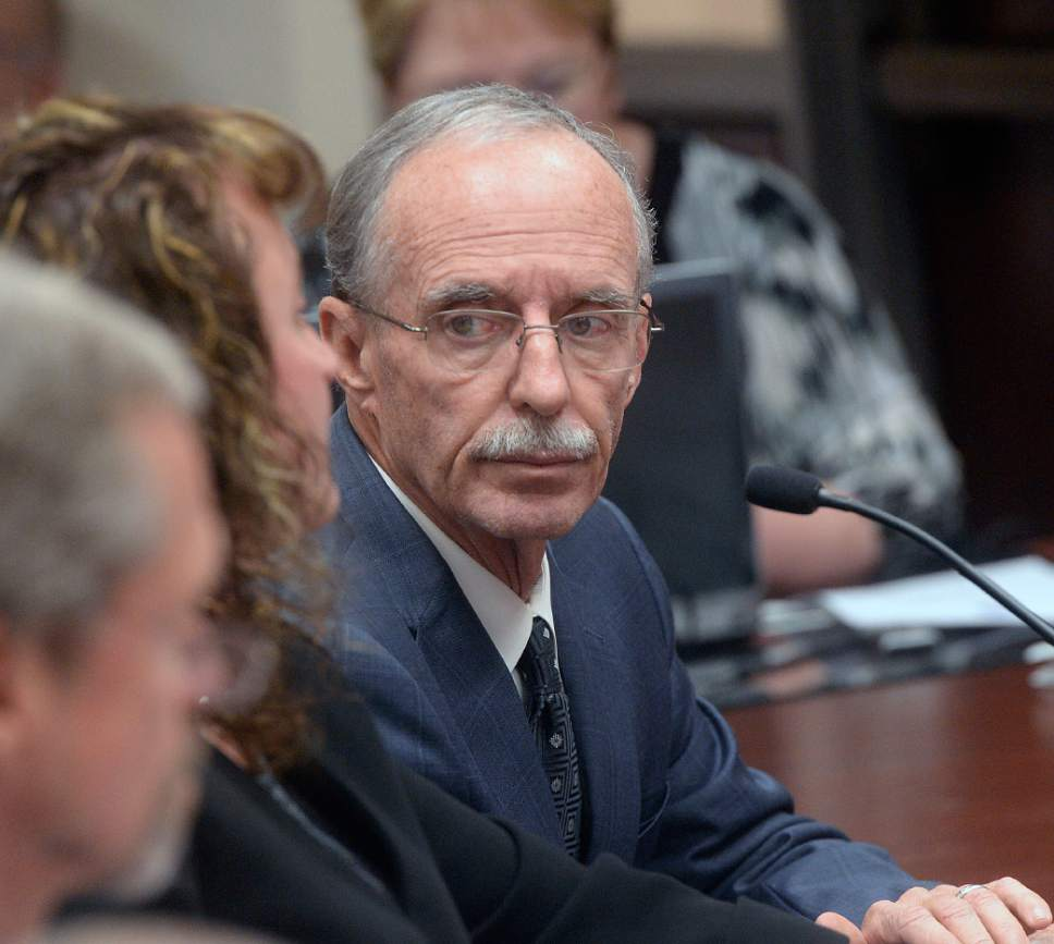 Al Hartmann  |   Tribune file photo Salt Lake County County Recorder Gary Ott sits with his chief deputy Julie Dole before the  Salt Lake County Council's presentation of findings of the county auditor's performance review in Oct. 2016. A week later, the Salt Lake County Republican Party censured Dole, accusing her of hiding Ott's health status.