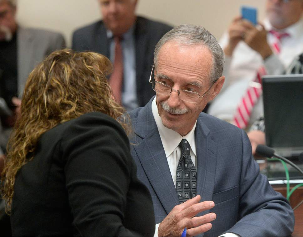 Al Hartmann     Tribune file photo Salt Lake County County Recorder Gary Ott sits with his chief deputy Julie Dole before the Salt Lake County Council's presentation of findings of the county auditor's performance review Tuesday, Oct. 4., 2016. A week later, the Salt Lake County Republican Party censured Dole, accusing her of hiding Ott's health status.