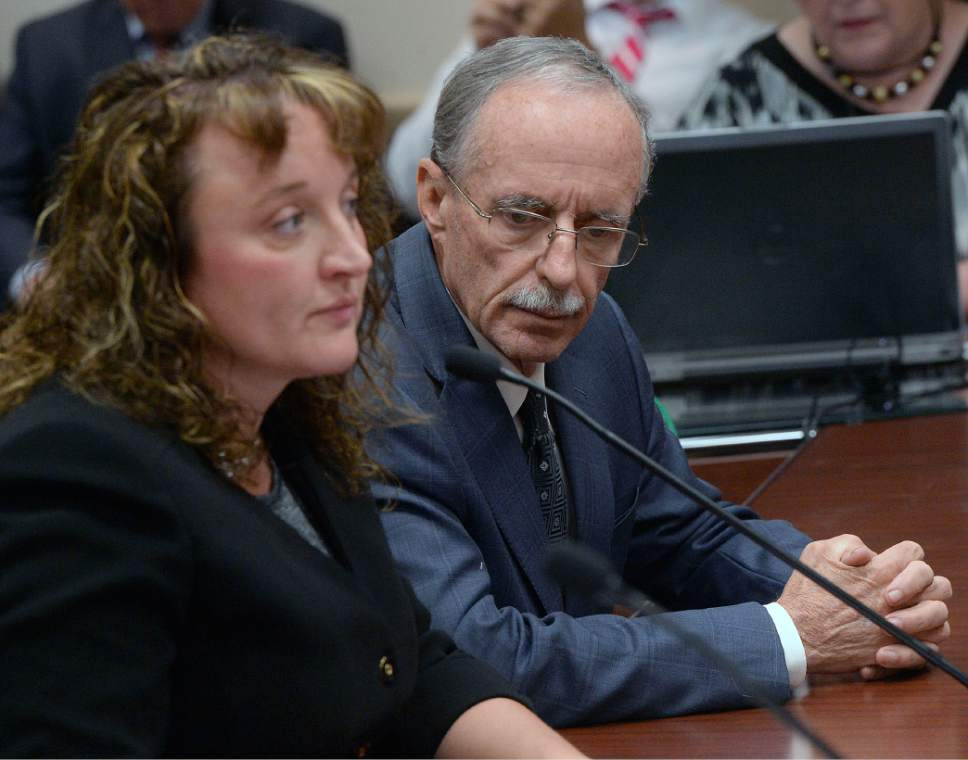Al Hartmann  |  The Salt Lake Tribune Salt Lake County County Recorder Gary Ott sits with his chief deputy Julie Dole, left, before the Salt Lake County Counci was to present findings of the county auditor's performance review last week. The Salt Lake County Republican Party censured Dole, accusing her of hiding Ott's health status.