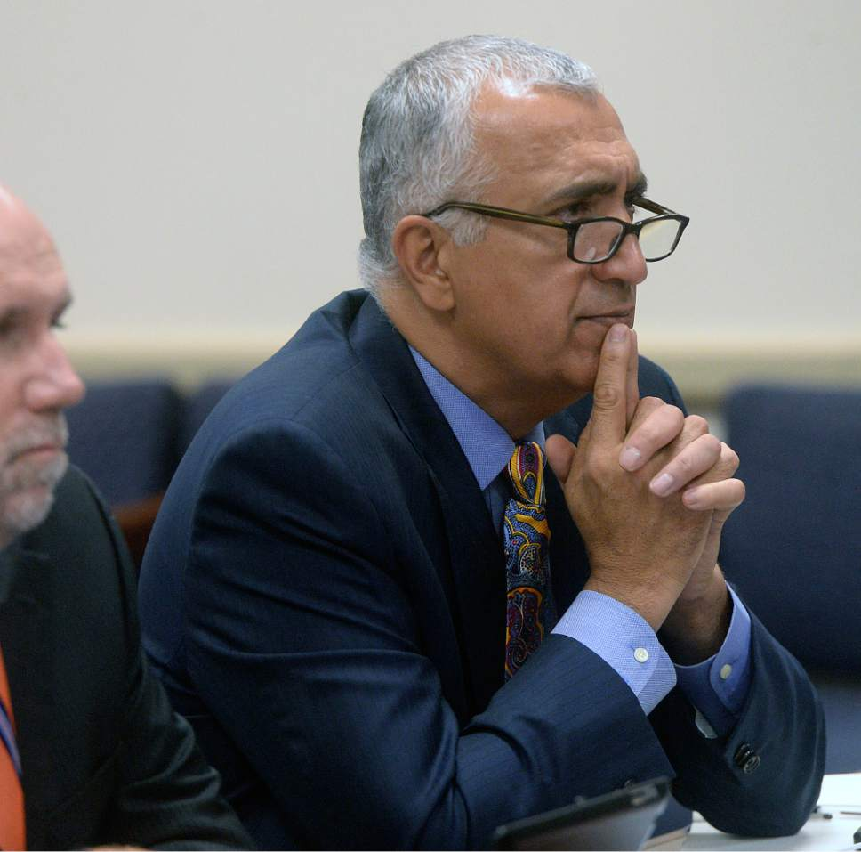 Al Hartmann  |  The Salt Lake Tribune Salt Lake County District Attorney Sim Gill listens as Salt Lake County County Recorder Gary Ott comments on findings of the County Auditor's performance audit of his office Tuesday Oct. 4.