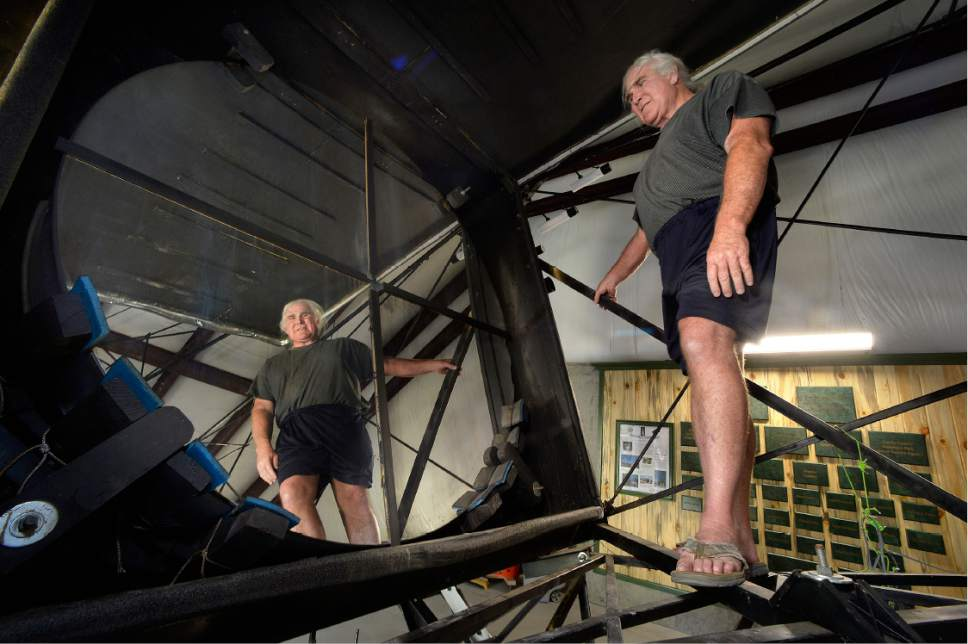 Scott Sommerdorf   |  The Salt Lake Tribune   Mike Clements is reflected in the 70 inch mirror as he stands inside the structure of the telescope he built in 2013 now housed at the Stansbury Park Observatory Complex, Friday, July 21, 2017. He believes it might be the largest amateur telescope in the world.