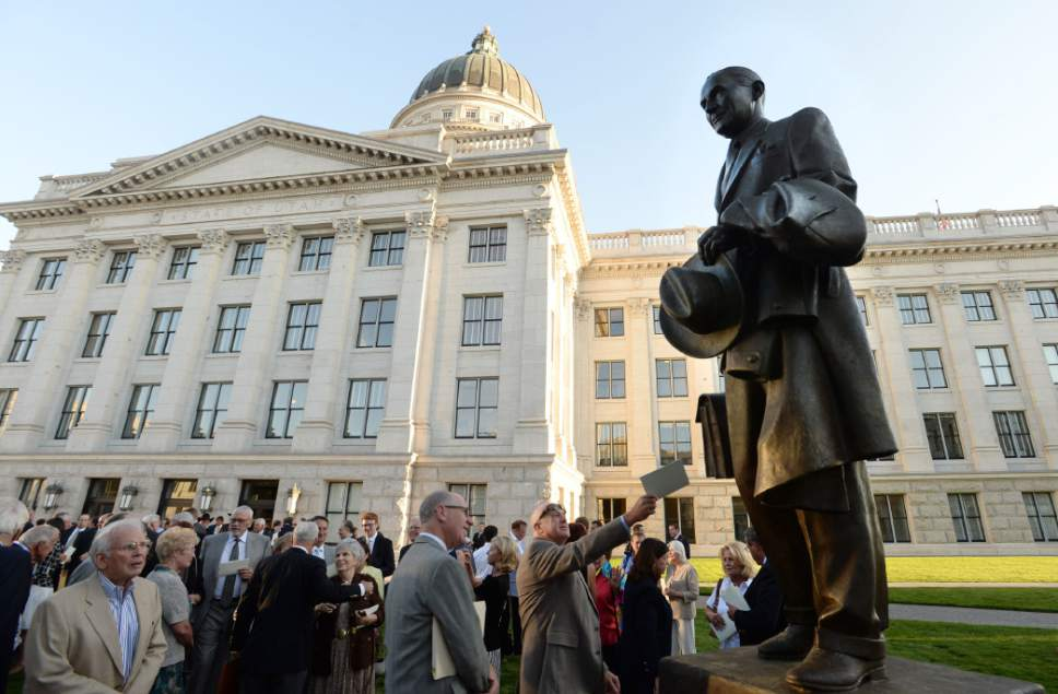 Steve Griffin  |  Tribune file photo   A statue of Marriner S. Eccles is unveiled during a program at the Utah State Capitol in Salt Lake City, Tuesday, September 16, 2014.  Marriner S. Eccles served as Chairman of the Federal Reserve Board from November 15, 1934, through April 14, 1948. He is widely credited for ensuring the central bank remained independent from political whims and private interests and for his policies that helped turn the corner from the Depression to a prospering country. The event marks the culmination of the Marriner S. Eccles Memorial Commission.