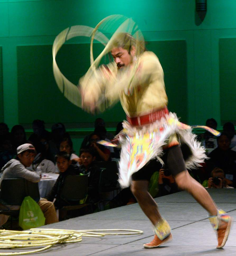Al Hartmann     The Salt Lake Tribune Carl Moore, Jr., a member of the Hopi Tribe, performs a hoop dance at the 2017 Governor's Native American Summit at Utah Valley University in Orem on Thursday, July 20, 2017. Native Americans from Utah tribes gathered to discuss educational and economic success, strengthening family relationships and celebrating native culture.