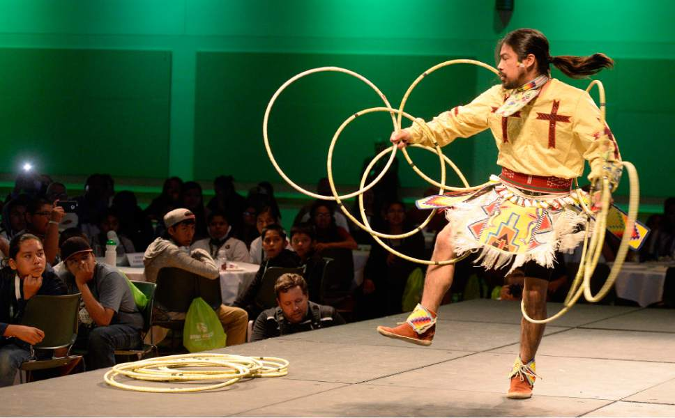 Al Hartmann     The Salt Lake Tribune Carl Moore, Jr., a member of the Hopi Tribe, performs a hoop dance at the 2017 Governor's Native American Summit at Utah Valley University in Orem on Thursday, July 20, 2017. Native Americans from eight Utah tribes gathered to discuss educational and economic success, strengthening family relationships and celebrating native culture.