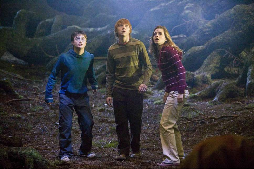 "Daniel Radcliffe as Harry Potter, Rupert Grint as Ron Weasley and Emma Watson as Hermione Granger in ""Harry Potter and the Order of the Phoenix,"" the fifth film in the series."