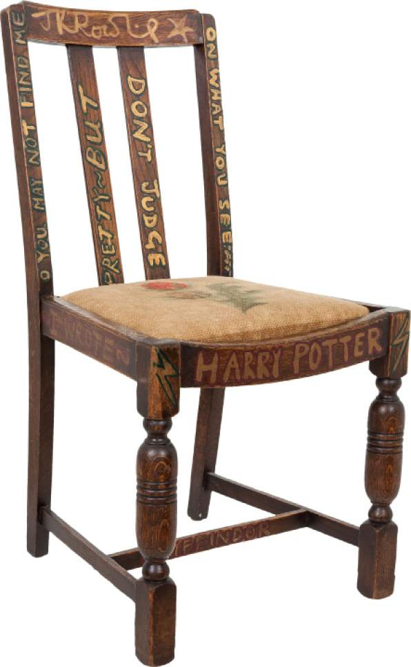 "This undated photo provided by Heritage Auctions shows the chair that J.K. Rowling sat on while writing the first two books of the Harry Potter series.  The chair, one of four old chairs a friend gave the starving artist when she began writing ""Harry Potter and The Sorcerer's Stone"" in 1995, is going on the auction block in New York City on April 6 with an opening bid of $45,000. (Heritage Auctions, Joseph Schroeder via AP)"