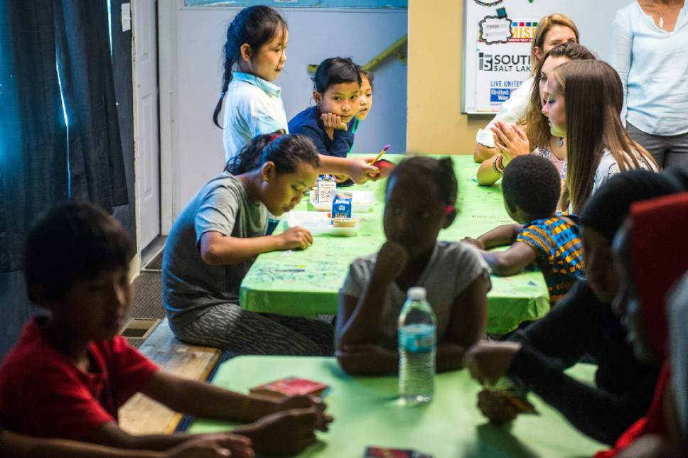 Chris Detrick  |  The Salt Lake Tribune  Children play cards and eat snacks at the Hser Ner Moo Community Center in South Salt Lake on Tuesday, July 18, 2017.