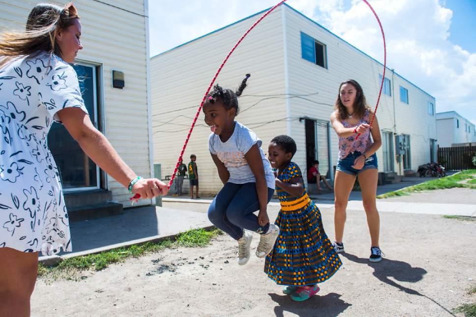 Chris Detrick  |  The Salt Lake Tribune  Learning for Life employees Savannah McDonald, left, and Ellie Jensen help Retaaj Ali, 6, and Rehema Ngunza, 6, jump rope at the Hser Ner Moo Community Center in South Salt Lake on Tuesday, July 18, 2017.
