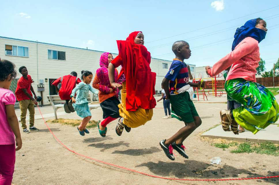 Chris Detrick  |  The Salt Lake Tribune  Promise Prevention Specialists Said Mohamed, left, swings the rope as Innocent Byiringiro, 11, Zahra Barat, 8, Fatima Barat, 11, Aswan Ahmed, 11, Hertier Irakiza, 11, and Sumeya Ahmed, 11, jump at the Hser Ner Moo Community Center in South Salt Lake on Tuesday, July 18, 2017.